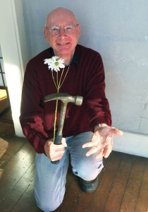 Man with flower and hammer
