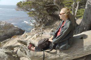 Woman alone looking at ocean