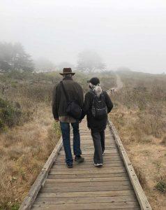 Couple walking in fog