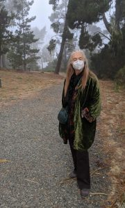 Maude in mask and fog